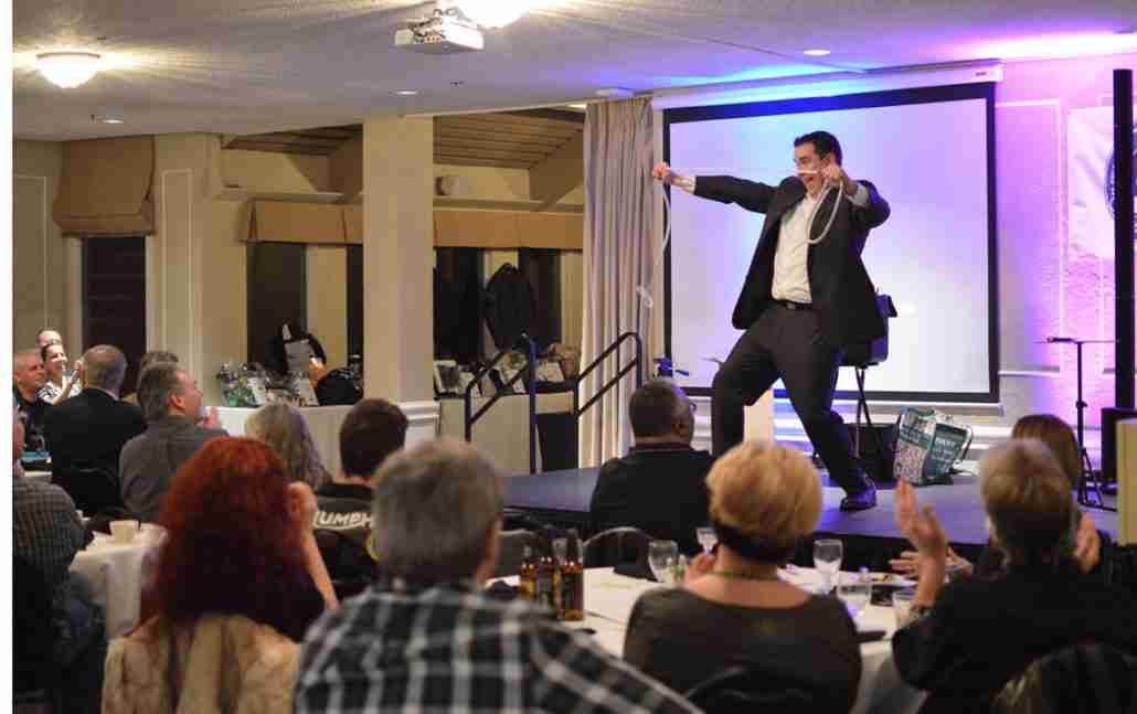 Oregon Magician Kevin Allen performs for a company banquet