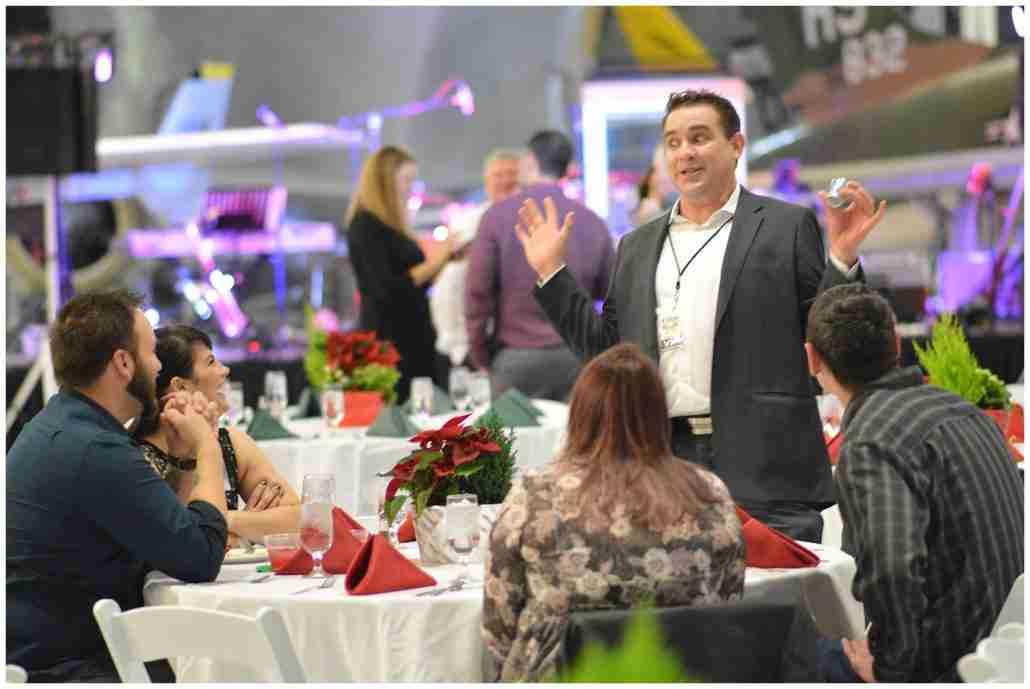 Magician Kevin Allen performs mingling magic at a company party